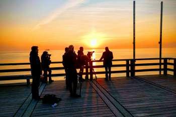Sunrise at Binz pier. The film crew with Ulrich Busch, real-estate project developer. © NOW Collective / Jörg Leine.