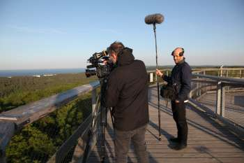 """Filming at the """"Eagle's Nest"""" observation tower at Naturerbezentrum Rügen by cameraman Marc Nordbruch and assistant Lorenz Brehm. © NOW Collective / Nico Weber."""